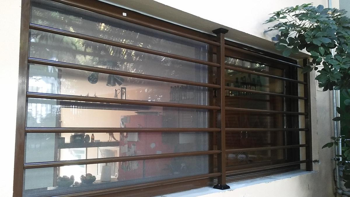 Fixed security bars Type – 70 installation on a big window